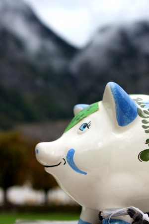 lay down: a ceramic pig lay down under mountain