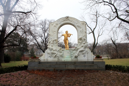 Famous golden statue of Strauss in stadtpark, Vienna, Austria photo