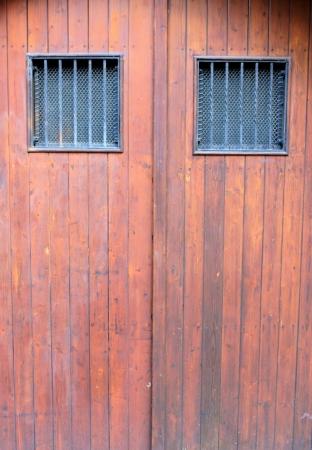 Wooden door with iron windows Stock Photo - 17401499