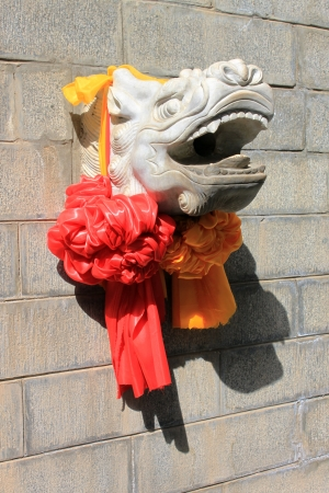 A Carve of Chinese Loong with silk balls
