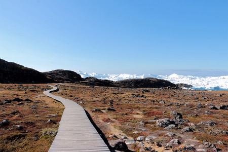 a wooden walkway towards Ilulissat Ice Fjord (jakobshavn) near Ilulissat in Summer