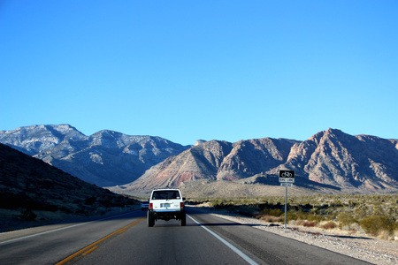 driving in the historical route 66 near Death Valley in Nevada in USA.
