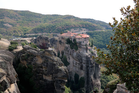 Meteora monasteries. day time view on the Holy Monastery of Varlaam placed on the edge of high rock Roussanou Monastery on background. Kastraki Greece