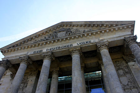 Reichstag building in Berlin, Germany. Dedication on the frieze means To the German people.