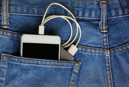 mobile phone with backup mobile battery in jean pocket