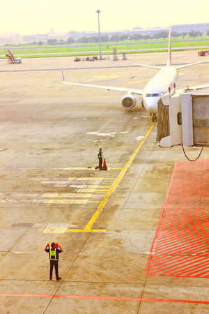 BANGKOK,THAILAND-5 SEPTEMBER;2019:Air Asia low cost airline loading cargo and luggage before departure.air staff working at apron  DON MUANG INTERNATIONAL AIRPORT in cloudy day.