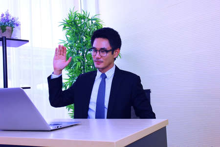 Asian business man say hello with worker  online work from home,online concept Standard-Bild