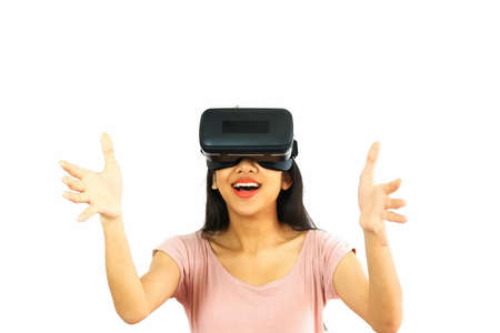 Asian young woman wearing virtual reality glasses device connect game ,entertainment ,mobile in social digital