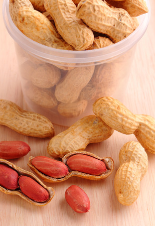 goober: groundnuts on wood background Stock Photo
