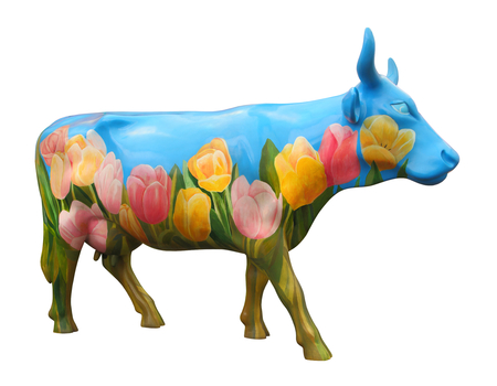 portly: cow statue painted with tulips isolated on white background