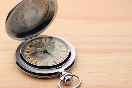 pocket watch: old pocket watch on wood background