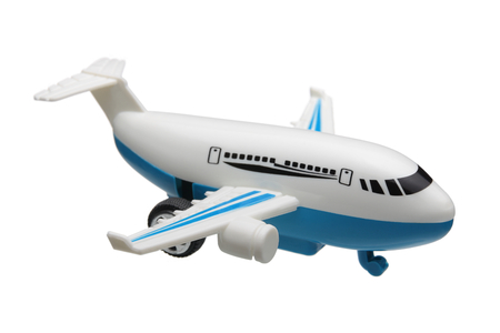voyage avion: plan de jouet en plastique isolé sur fond blanc