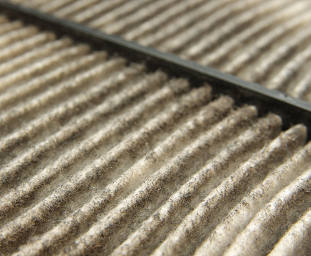 airflow: close up of dirty car air filter