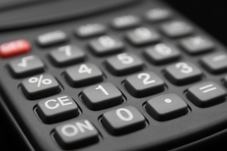 compute: close up of calculator keypad in black background Stock Photo