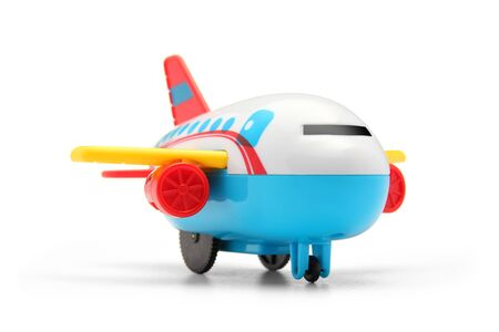 colourful plastic toy plane on white background