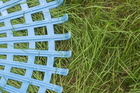 harrow: Plastic harrow on grass field