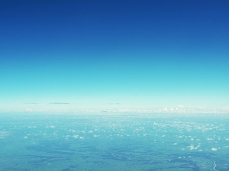cloud drift: Clear blue sky view from airplane window