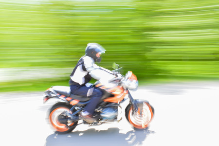 blurr: Joung man going fast on a motorcycle, blurr motion picture.