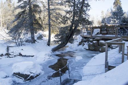 frozen river: Partly frozen river running along a deck.