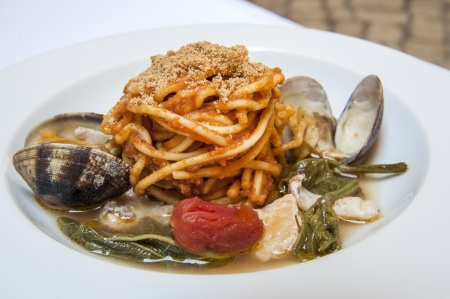 Italian pasta with tomato and seafood photo
