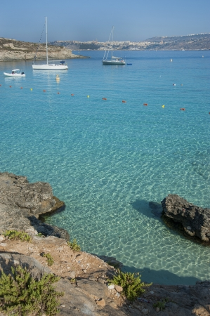 europe, mediterranean, malta, comino island, clear blue sea in blue lagoon photo