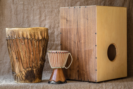 Hamdmade percussion instruments - Djembe and Cajon Stock Photo