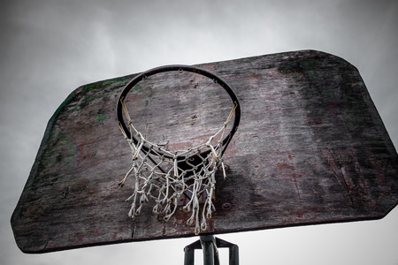 the height of a rim: Old street basketball hoop and board