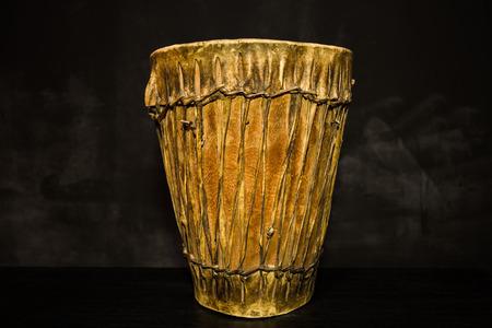 djembe drum: Handmade djembe drum on black background