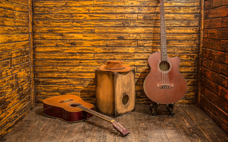Acoustic music instruments on wooden stage