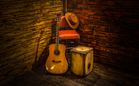 acoustical: Acoustic instruments on small stage in bar Stock Photo