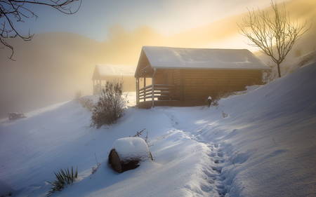 Log cabin on winter morning Stock Photo