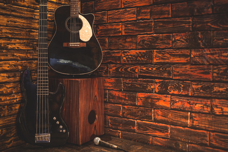 Music instrument on wooden stage in Pub Stock Photo
