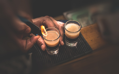 baileys: Two B 53 cocktails with lighter Stock Photo