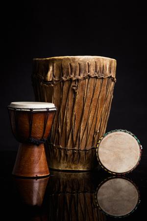 rhythm rhythmic: Three old handmade Djembe drums Stock Photo