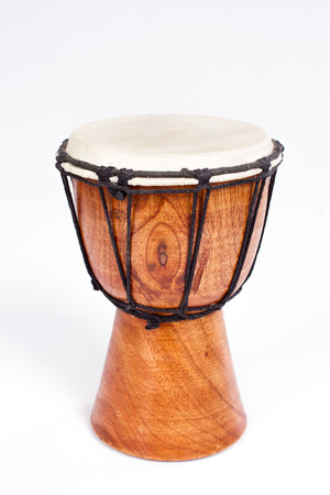 Single Djembe drum isolated on white 스톡 콘텐츠