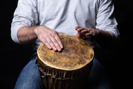 Man playing african djembe drum