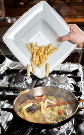 Penne Pasta with vegetables in pan