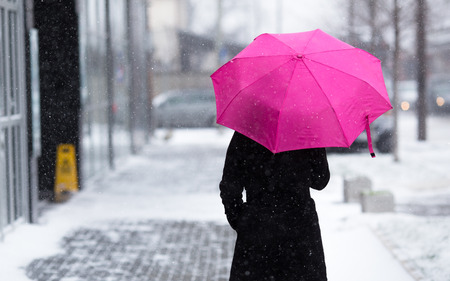 Woman with umbrella on snowy day