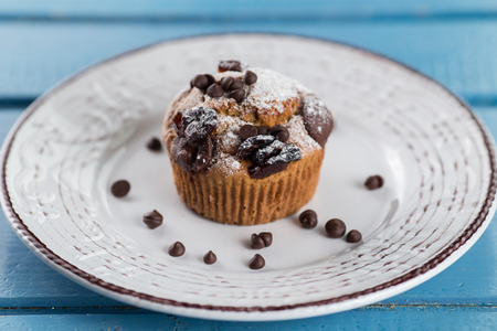 One chocolate muffin on plate