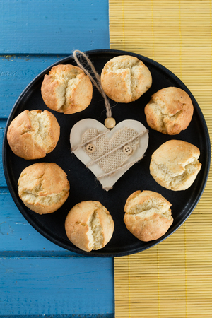 Biscuits with ricotta on black plate