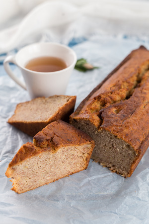 Fresh homemade banana bread  with cup of tea
