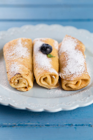 Three homemade rolled pancakes with blueberry Standard-Bild