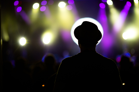 Silhouette of man at music festival Stock Photo