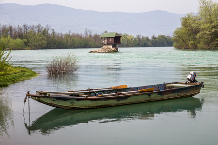Lonely house and small boat on the river Drina, Serbia