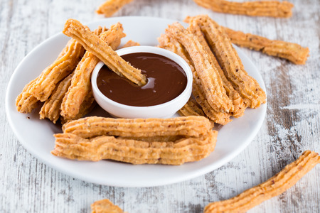 Traditional Spanish dessert churros with chocolate 写真素材