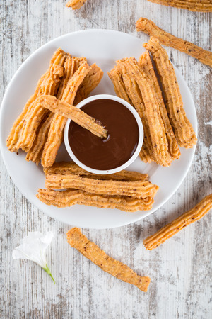 Traditional Spanish dessert churros with chocolate Stock Photo