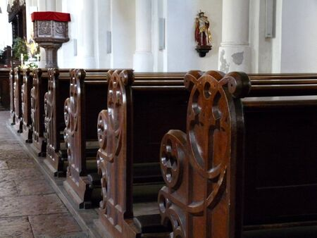 View to old wood church bench in cathedral 写真素材