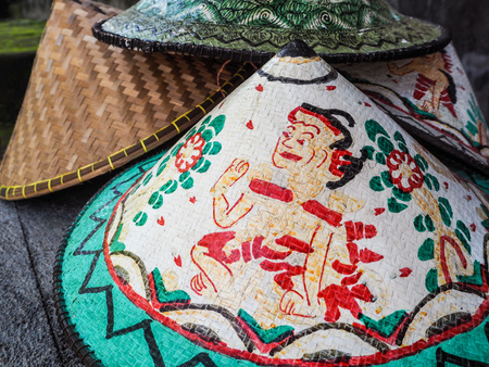 sold small: Colorful traditional conical hat with a special design sold at a small shop in Bali, Indonesia