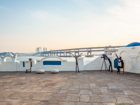 Metal sculptures on the Haeundae promenade promoting the Busan International Film Festival with the Gwangan bridge in the background during sunset, Busan, South Korea Editorial