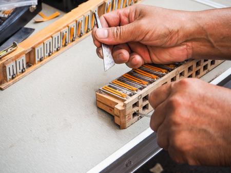 Old man repairing the reed blocks of a vintage accordion, Beijing, China Stock fotó